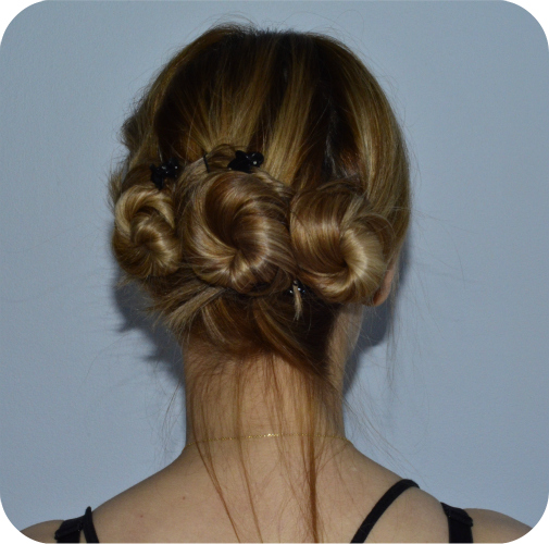 cute messy updo triple bun hairstyle