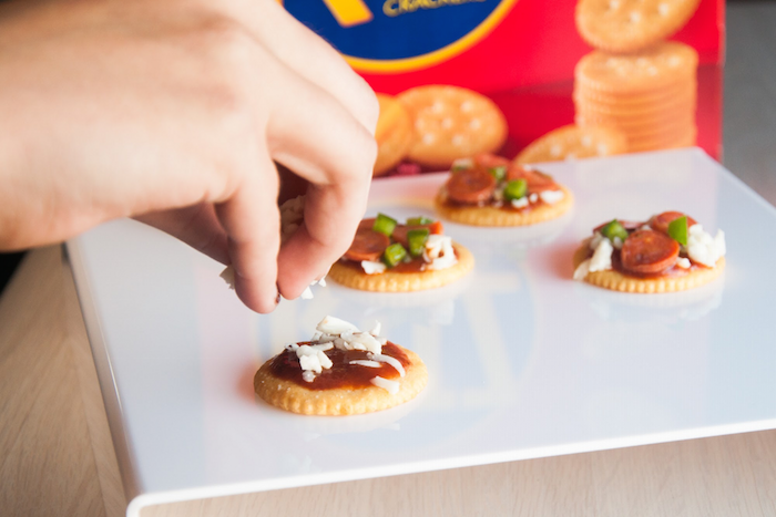 Making Ritz Mini Pizzas